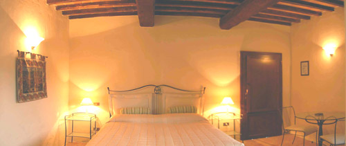 one bedroom of tuscan rental villa