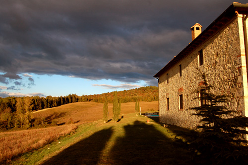 Tuscan farmhouse in the autumn, at sunset