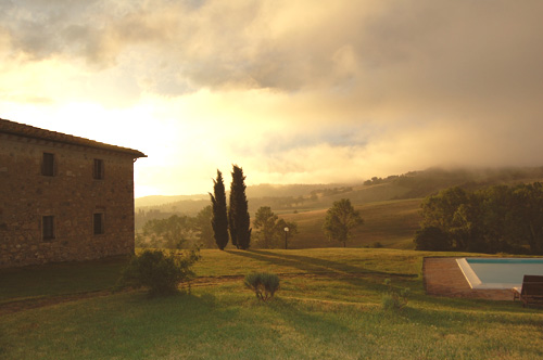 autumn in the tuscan villa with pool and light mist