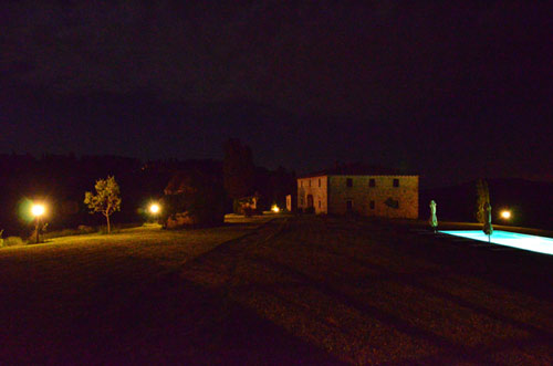 country house pool in tuscany by night