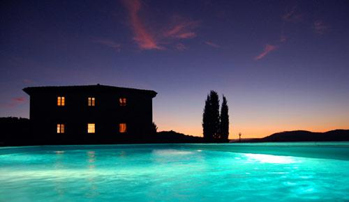 night potography of tuscan villa pool