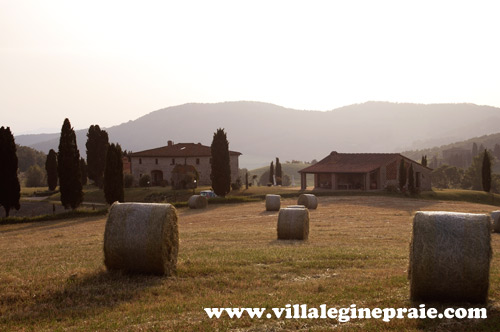 villa in tuscany with haystacks
