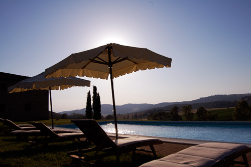 The pool of tuscan villa at the sunset