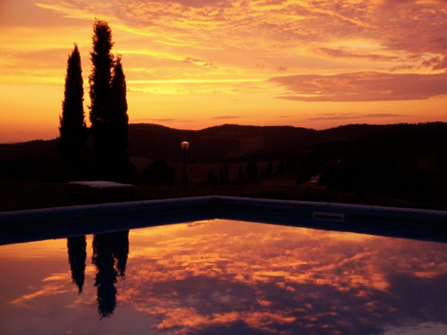 sunset at the pool of the villa