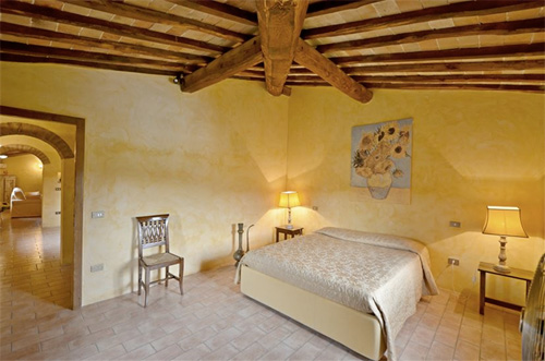 the bedroom of tuscan farmhouse