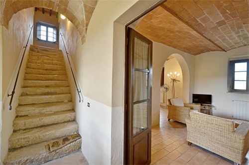 entry by the loggia of the tuscan villa