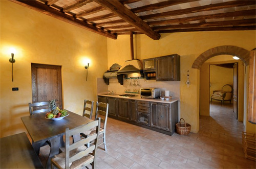 the kitchen of the farmhouse in tuscany
