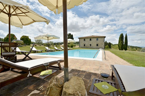 the tuscan pool with teak sun beds