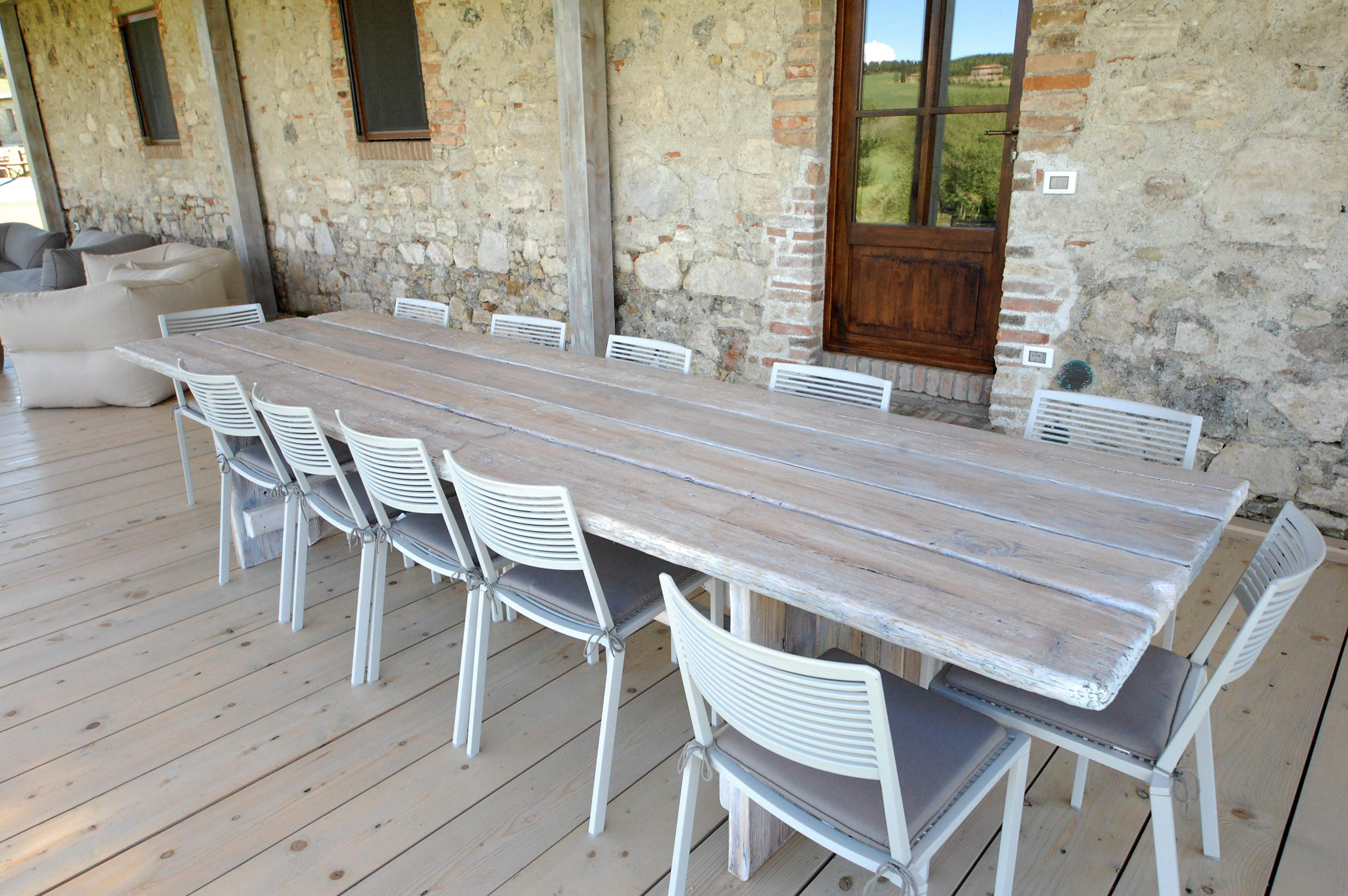 pergola: Tuscan wooden table