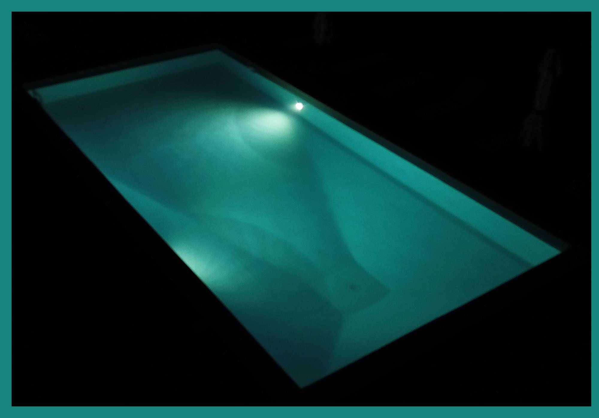 villa tuscany exlusive pool illuminated in the night